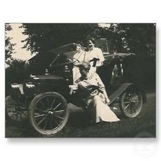 3_ladies_posing_by_old_car_post_card_postcard-p239938920352122542qibm_400